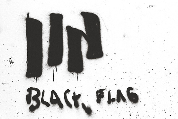 black flag logo sprayed on a wall